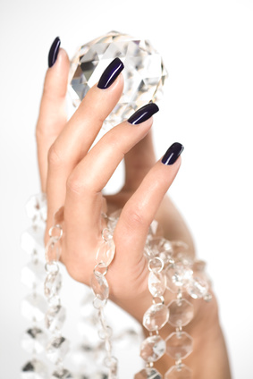 Beautiful woman hands with big diamond