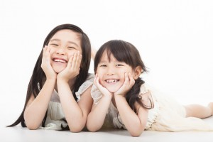 happy two asian girls  on the white background