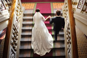bride and groom walk up the stairs. top view