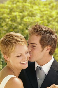 Bridegroom kissing bride