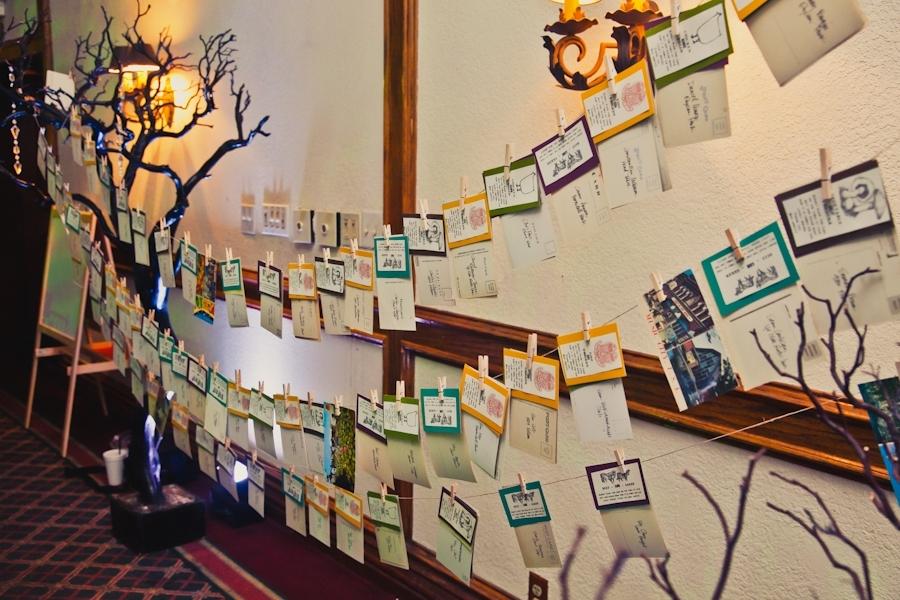 unique-wedding-reception-idea-escort-cards-hanging-clothes-pins.full