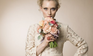 Female model posing with a bouquet