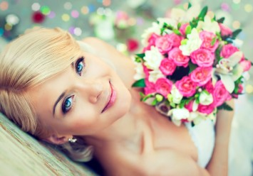Beautiful blonde bride with a bouquet of flowers