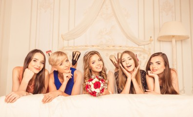 girls celebrate a bachelorette party of bride. bridesmaids lying