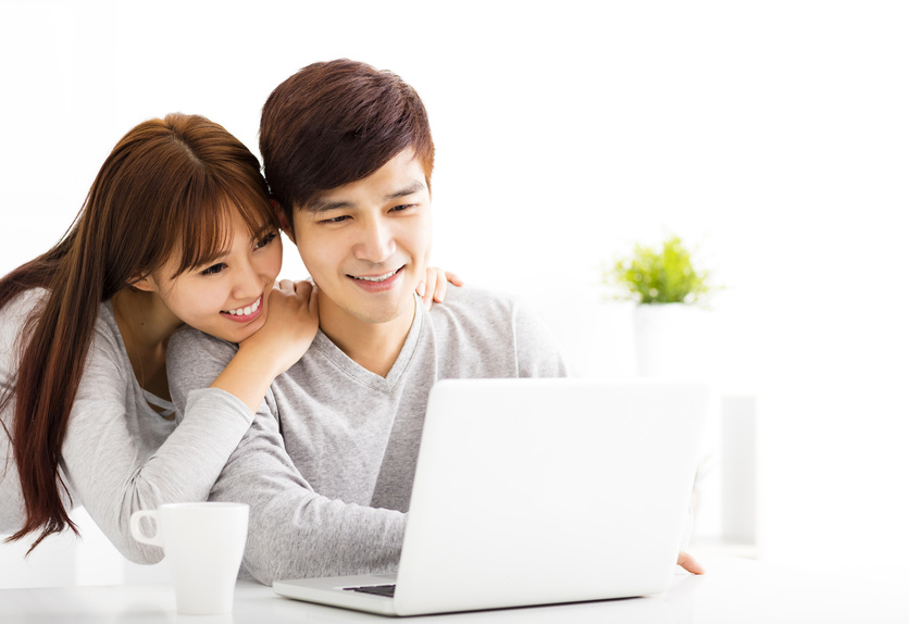happy young Couple with Laptop In living room